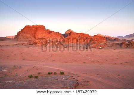 Scenic View Of Wadi Rum Against Clear Sky During Sunset, Arabian Desert, Jordan Cross-processed. Vintage style. Instagram filter