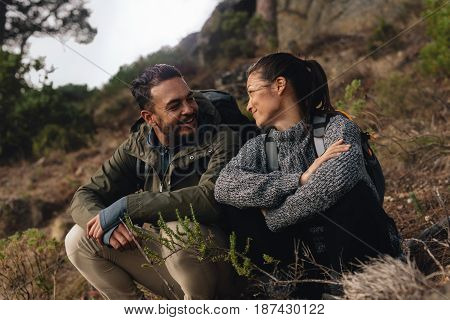 Young Couple Taking A Break On A Hike