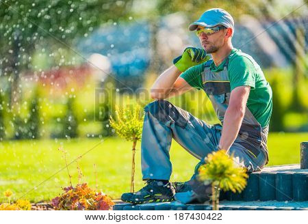Professional Caucasian Garden Designer in His 30s Taking Break To Rethink New Landscaping Ideas. Gardening Concept.