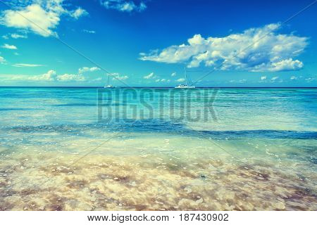 Caribbean sea. Tropical exotic water landscape with yachts on horizon. Topical paradise. Ocean nature. Saona Island. Domincan Republic