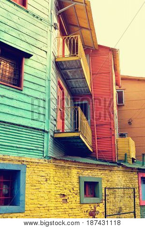 Streets of La Boca in Buenos Aires Argentina with number of colorful houses and tango teachers.