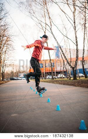 Roller skater legs in skates on asphalt walkway