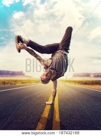Young male hip hop dancer posing on a road