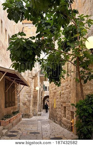 Man walking on empty street n old town of Jerusalem. Jerusalem Old City. Israel