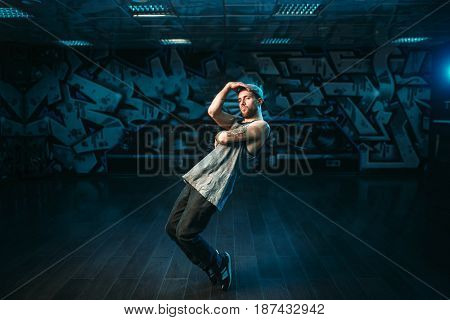 Male rapper in dance studio, rap performer