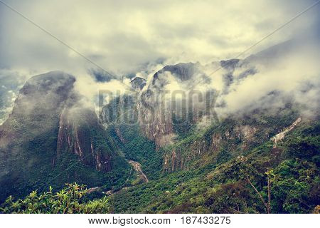 MACHU PICCHU PERU - MAY 31 2015: View from the ancient Inca City of Machu Picchu on Urubamba river.