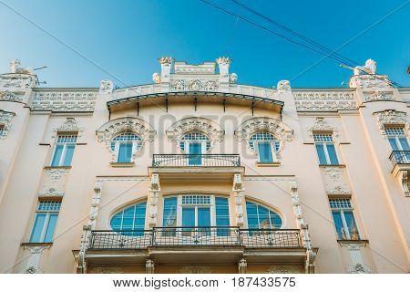 Riga, Latvia. Facade Of Old Art Nouveau Building designed by Mikhail Eisenstein on 4 Alberta Street. Sunny Summer Day Under Blue Clear Sky.