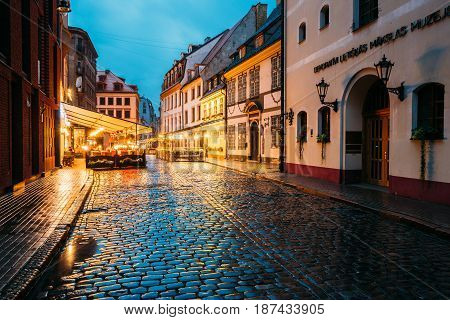 Riga, Latvia - July 3, 2016: The Museum Of Decorative Arts And Design MDAD And Cafe In Lighting At Evening Or Night Illumination In Old Town In Skarnu Street