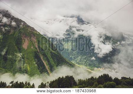 mountains with green grass and stormy sky landscape