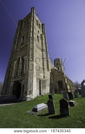 Wymondham abbey cemetery. Ancient Norman religious building. Church with graveyard headstones from Norfolk in the UK.