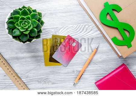 student's desk with dollar sign for fee-paying education set gray wooden background top view