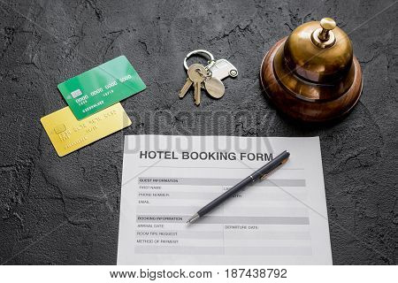 room reservation form on hotel reception dark desk background