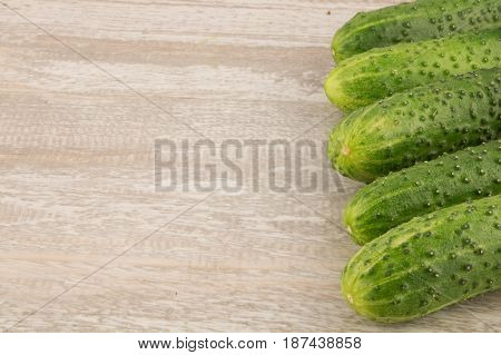 Cucumber On White Wooden Background Close Upcopy Space .