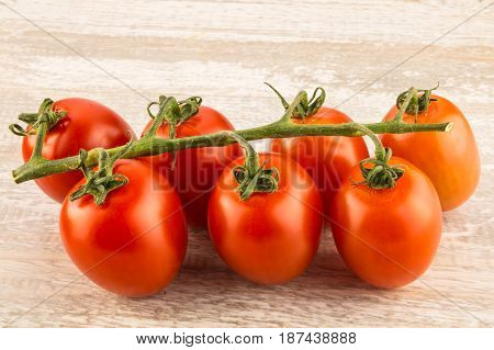 Tomatoes On A White Wooden Background Close Up.