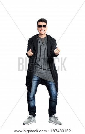 Casual young man wearing sunglasses, hands up, bent backwords, happy, positive attitude, full lenght, isolated on white