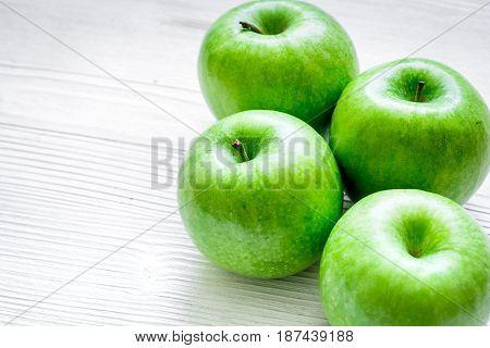 green apples for healthy fruit dessert on white table background
