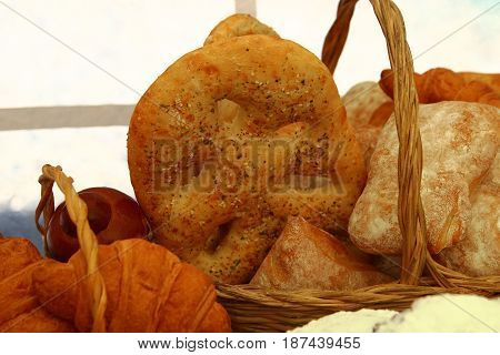 bakery products in wicker basket on table