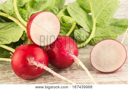 Juicy Fresh Radish In A Cut On A White Wooden Background Close Up.
