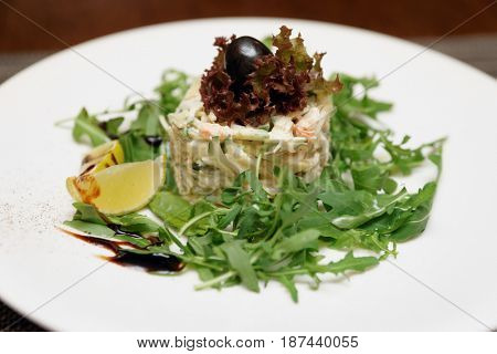 Seafood appetizer with crab and rocket salad