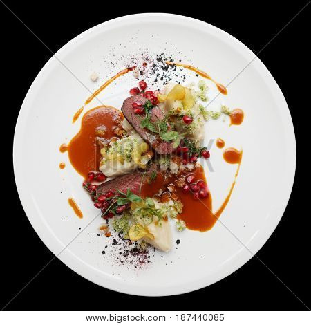 Venison fillet and potato puree, gourmet dish isolated on black background