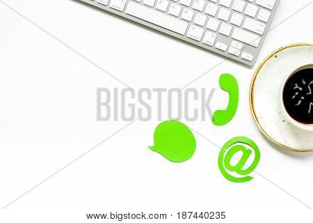 customer support company office with contact us sign and coffee on white desk background top view mockup