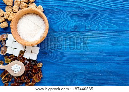 cooking sweets set with sugar in bowls on kitchen blue table background top view mock-up