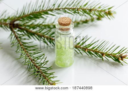 spa and aromatherapy with organic sea salt in glass bottles on white table background