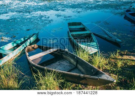 Abandoned Old Wooden Fishing Boats In Summer Lake Or River. Beautiful Summer Sunny Day Or Evening. Forsaken Boat. Russian Nature
