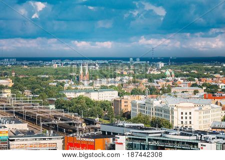 Riga, Latvia - July 1, 2016: Aerial Cityscape In Sunny Summer Day. Top View Of Landmarks - Riga Central Station, St. Francis Church, Ministry Of Transportation And All Saints Church.