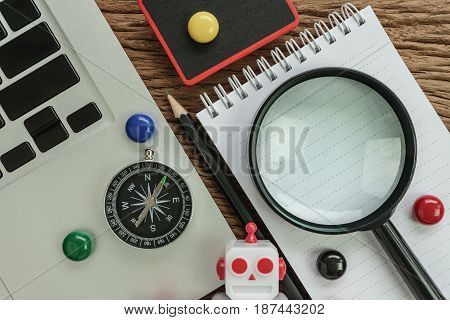 SEO search engine optimization website analysis concept with pencil compass computer and magnifying glass on wood table.