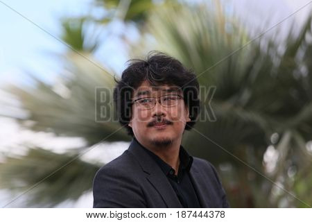 Bong Joon-Ho attends the 'Okja' photocall during the 70th annual Cannes Film Festival at Palais des Festivals on May 19, 2017 in Cannes, France.