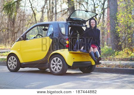 MOSCOW - OCT 25, 2016: Woman (with model release) in trunk of Mercedes Smart in Sokolniki where conducted Auto Show - Oldtimer, Gallery