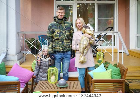 MOSCOW - OCT 25, 2016: Father, baby, mother, girl (with MR) at terrace in summer residence of Mosdachtrest company, which manages summer houses fund, services and rents out-of-town property