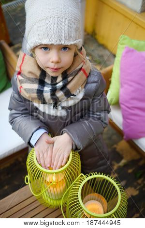 MOSCOW - OCT 25, 2016: Girl (with MR) warms her hands over candle in summer residence of Mosdachtrest company, which manages summer houses fund, services and rents out-of-town property