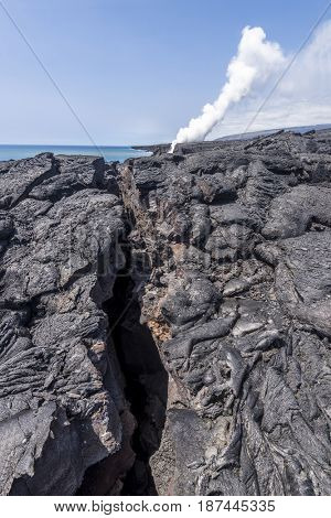 A long volcanic surface fissure formed from Kilauea volcano in Hawaii shows the devastation eruptions cause.
