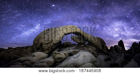 The Milky Way formed over Joshua Tree's Arch Rock.  This is a panoramic perspective requiring eight stitched images to get a 180-degree perspective.