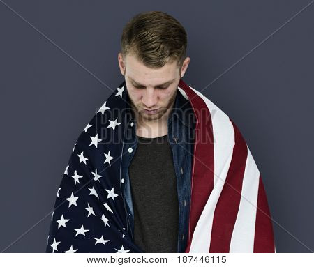 Man close up holding flag around shoulder posing for photoshoot