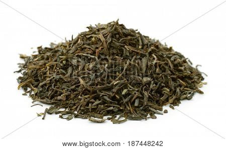 Pile of dry green tea leaves isolated on white