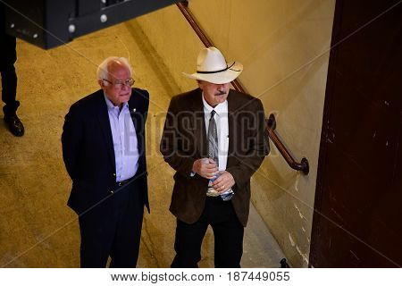 MISSOULA, MONTANA, USA - May 20, 2017: US House candidate Rob Quist waits with US Senator Bernie Sanders to take the stage during the 2017 Montana special election rally at the University of Montana