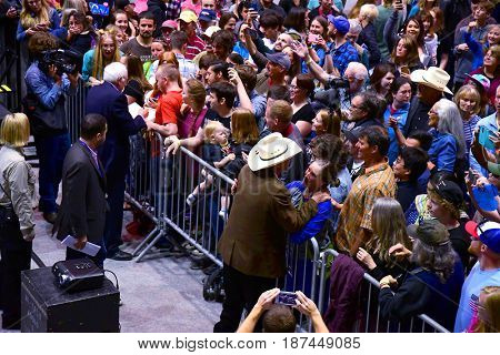 MISSOULA, MONTANA, USA - May 20, 2017: Senator Bernie Sanders and US House candidate Rob Quist greet supporters and sign autographs at a rally at University of Montana