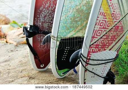closeup of surfboard on beach ready for surfing