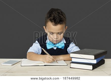A Caucasian Boy Studying Writing Background Studio Portrait