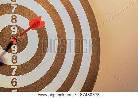 Red dart target arrow hitting on bullseye with sun light vintage stylemetaphor to target marketing and business success concept