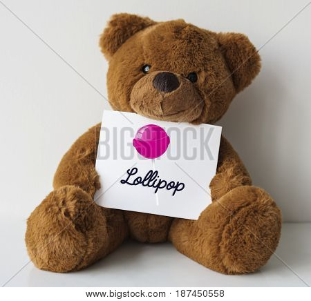 Teddy bear with illustration of sweet candy lollipop