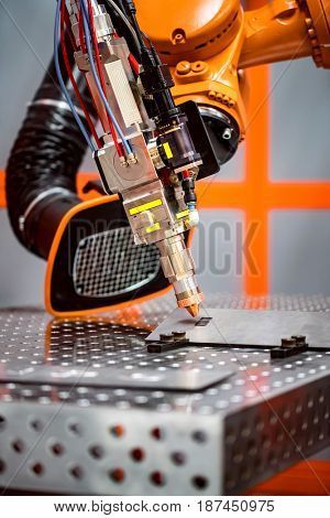 Fibre laser robotic remote cutting system. CNC Laser plasma cutting of metal, modern industrial technology.