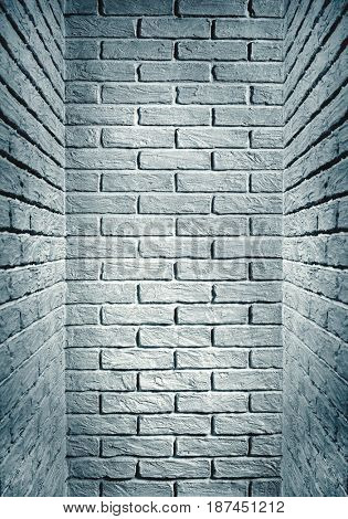 cyan toned brick wall end of the corridor, abstract background photo