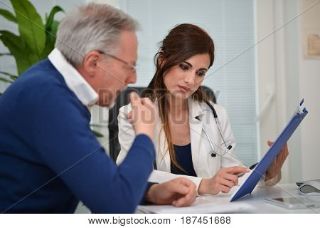 Doctor talking to his patient during a visit