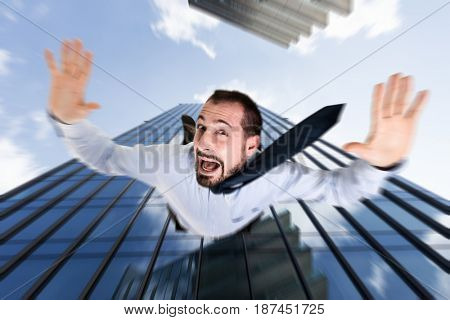 Businessman falling from a skyscraper