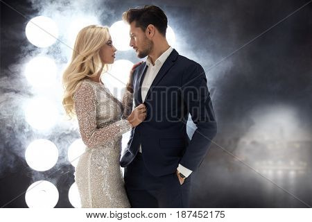 Romantic style portrait of an elegant couple in the night club