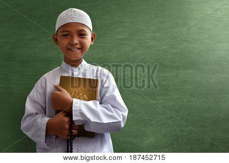 Asian muslim kid smile in class room